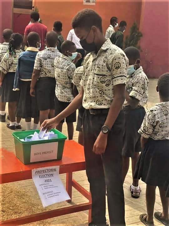 A student casting his vote during the election